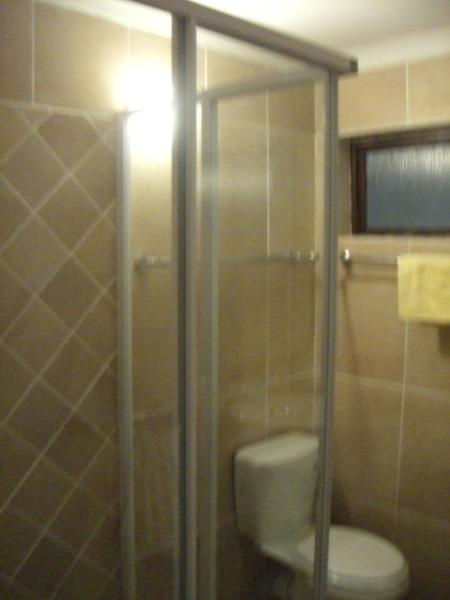 The spacious shower in the second bathroom is ideal for quick refreshment