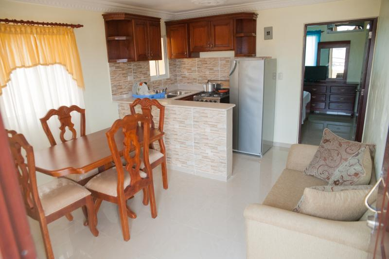 Dining room and Equipped Kitchennette, kitchenware, dishware and sofa