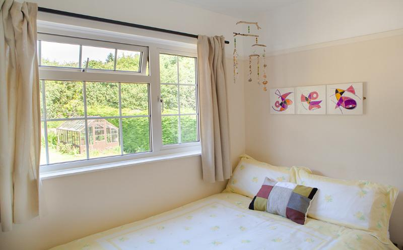 sunny double bedroom to the rear with garden views at The Pink House Lulworth