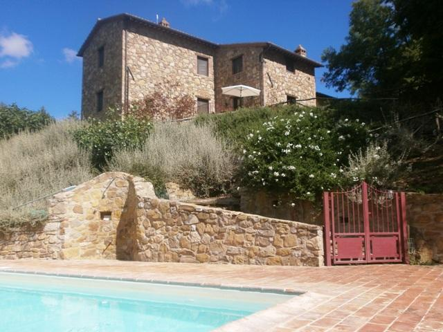 View of the farmhouse from pool.