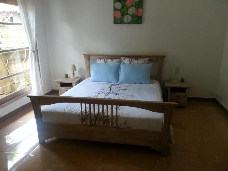 Bedroom Satu with garden view.