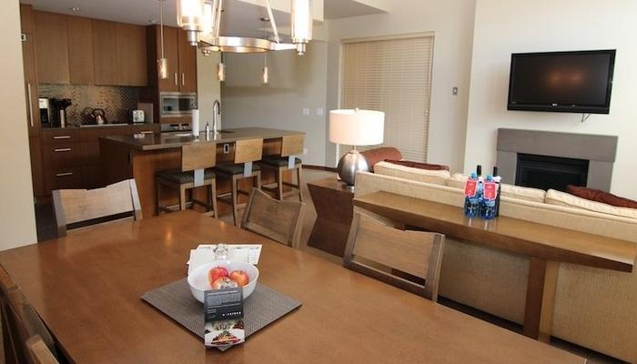 A large dining table and stools for extra seating make this condo perfect for a group