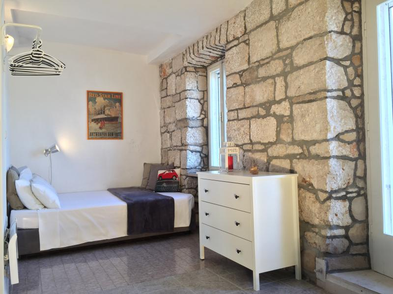 Romantic bedroom with the view to the old town Korcula.