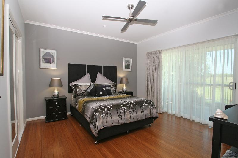 Master bedroom with large walk-in robe, TV