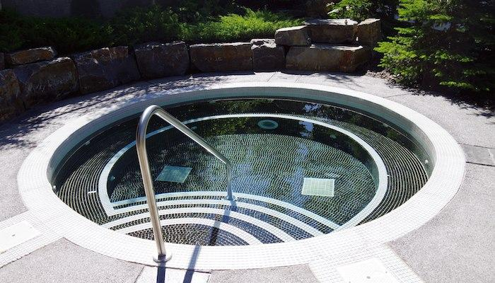 Enjoy a soothing soak in the outdoor hot tub