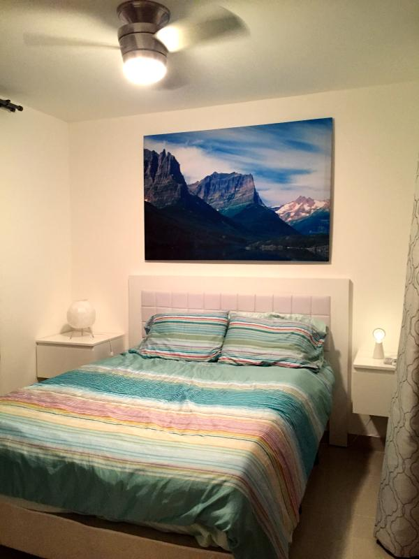 Bedroom with AC and Ceiling Fan