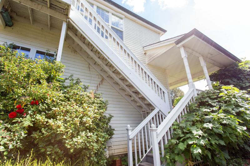Stairs to porch with seating, stairs to Apartment