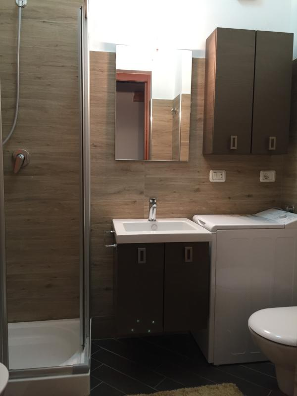 The bathroom with the shower.