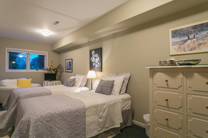 Second Bedroom with New, Comfortable Twin pillow Top Beds, fine linens  Oversized Armchair and T.V.