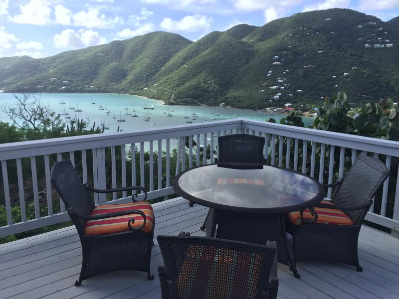 Enjoy dinner and drinks on the deck overlooking Coral Bay, St. John