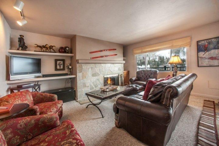 Cozy living room, open to dining and kitchen and includes spectacular views of Vail Mountain.