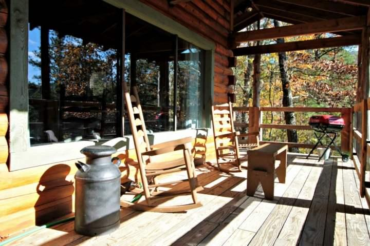 Porch offers plenty of seating for the whole family, as well as a charcoal grill and hot tub!