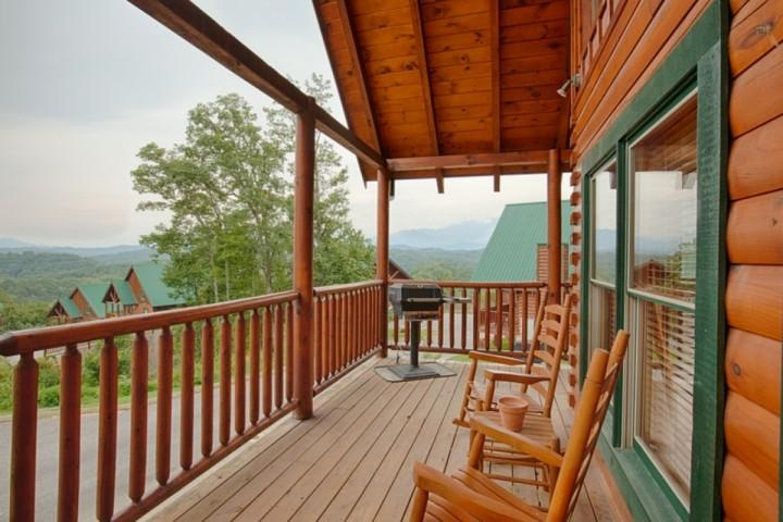 Porch features a grill, and plenty of seating for you and your guests!