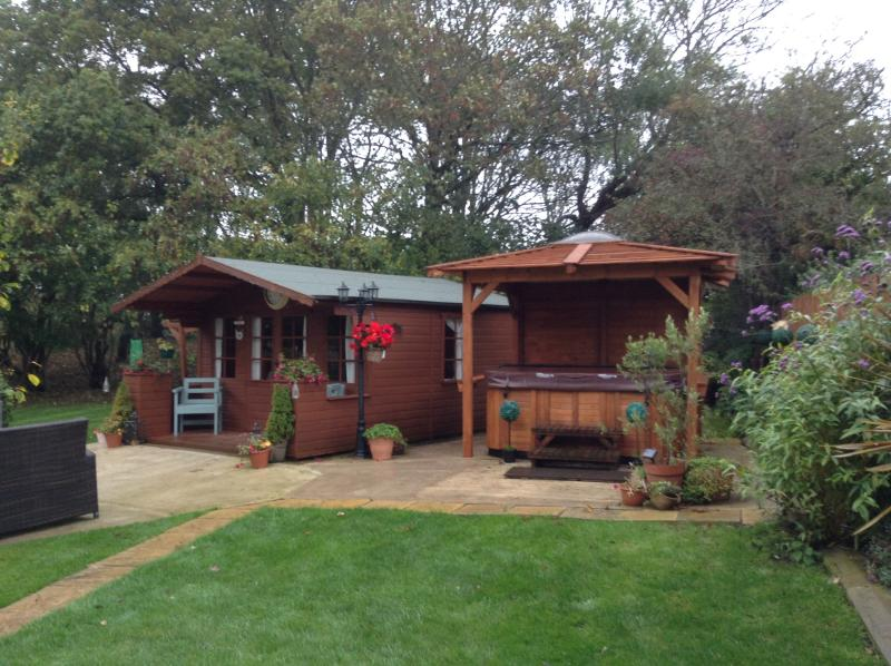Hot tub with new wooden gazebo, keeps you lovely and sheltered with clear roof to view the stars