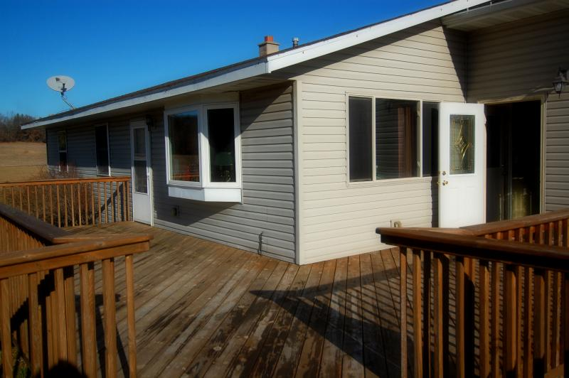 large deck for entertaining - 3 season patio is adjoining.