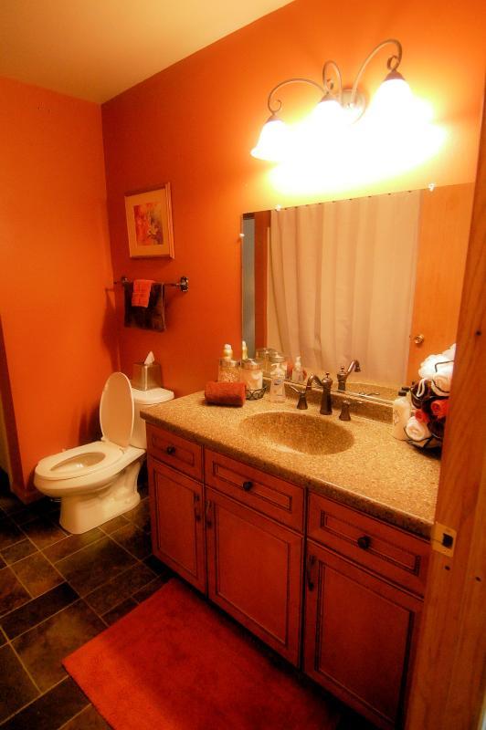 Upper level bathroom with tub and shower rain head