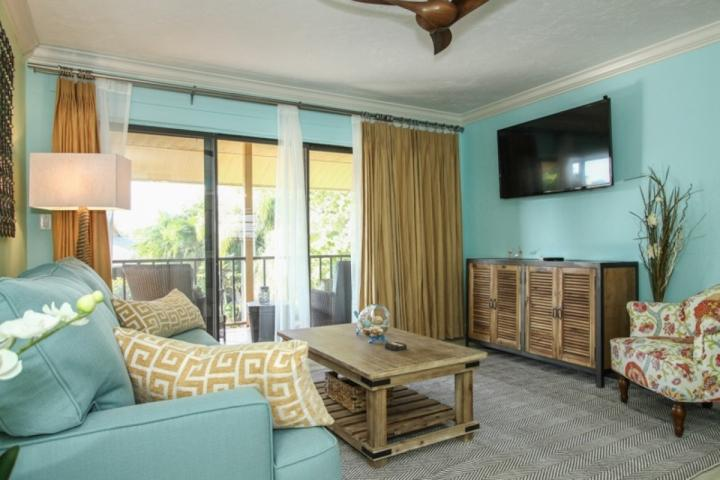 Huge fifty inch flat screen TV in this designer decorated living area w/ balcony views