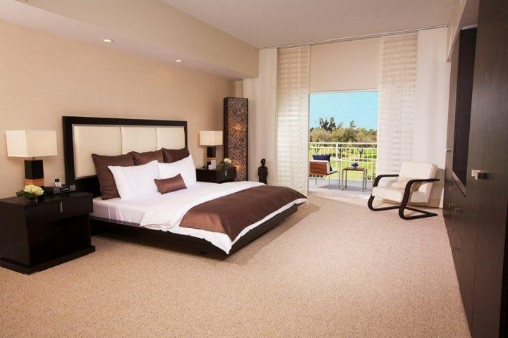 Luxury master bedroom complete with a king size bed and large flat screen TV.
