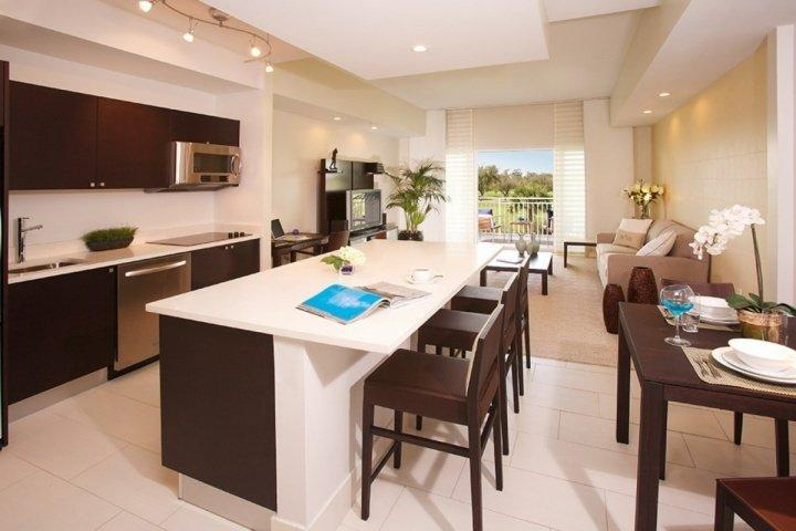 Fully functional gourmet kitchen with stainless steel appliances, and all items necessary to prepare and serve a meal.