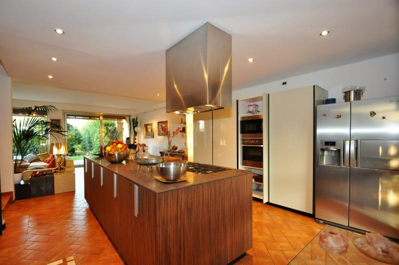 Hitech kitchen with hidden ovens and american fridge with ice maker and fresh water dispenser