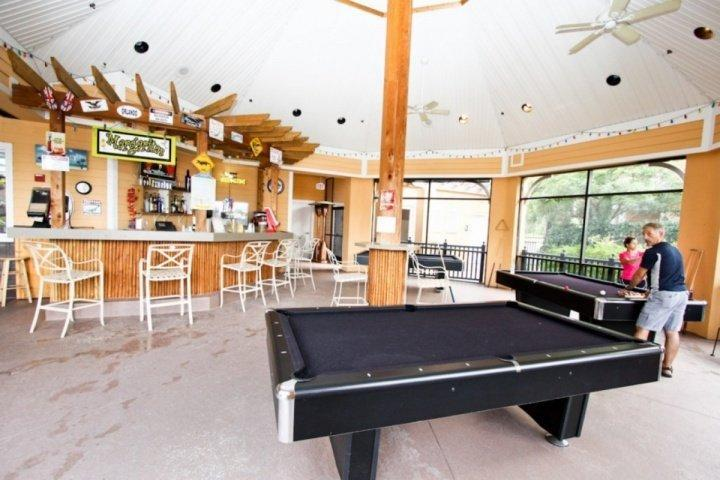 Relax with a game of pool at at Bahama Bay Resort