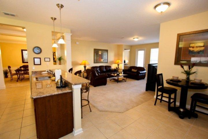 Open Dining Area, Living Area and Kitchen Area w/Patio Access From Living Area