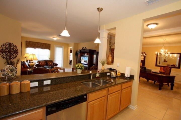 Modernt kök w / rostfritt stål apparater och granit bänkskivor