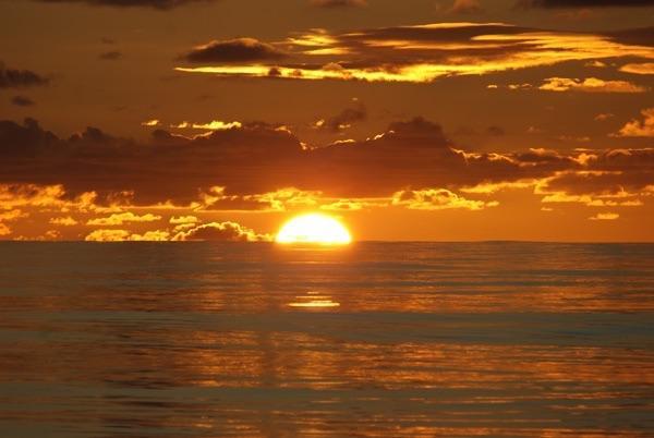 Refleje en su día como el sol se pone!