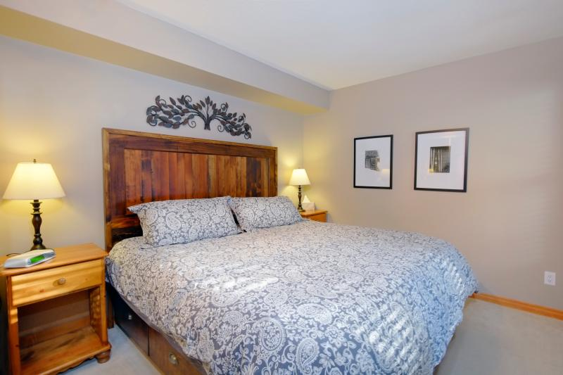Our front bedroom has a king bed with drawers for storage.