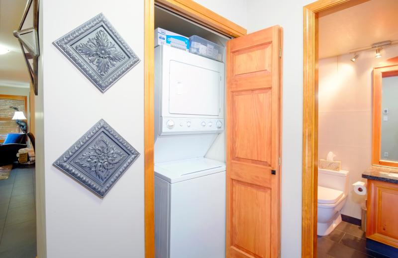 Washer and dryer with detergent provided for your use during your stay.