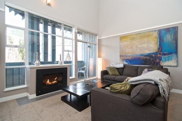 Spectacular grand living room, vaulted ceilings, plenty of natural light, custom art work and modern decor