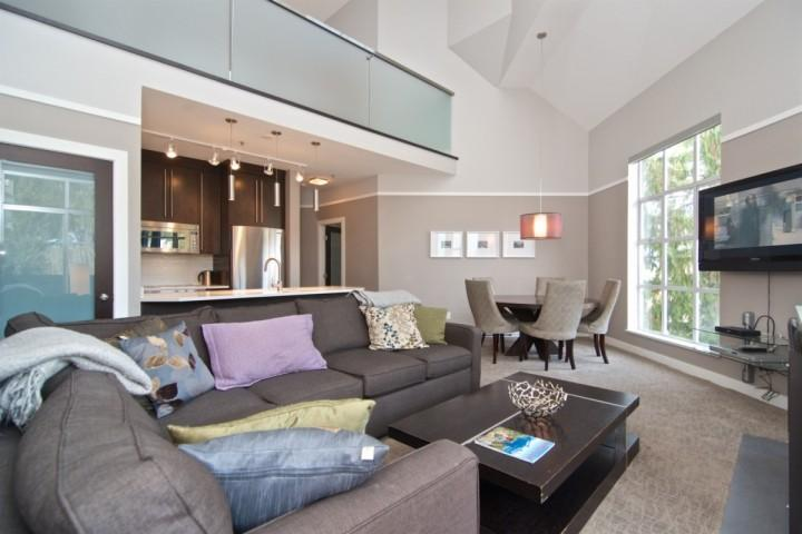 Open concept living room, custom sectional, full dining room and large screen TV