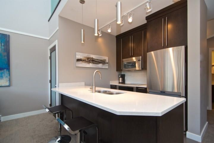 Over sized island with breakfast bar, full size top of the line appliances