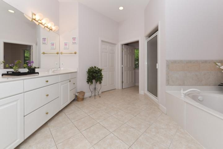 Master Bath with dual vanity, jetted tub, shower and large walk in closet
