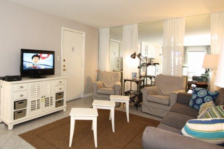 Living room area with flatscreen TV