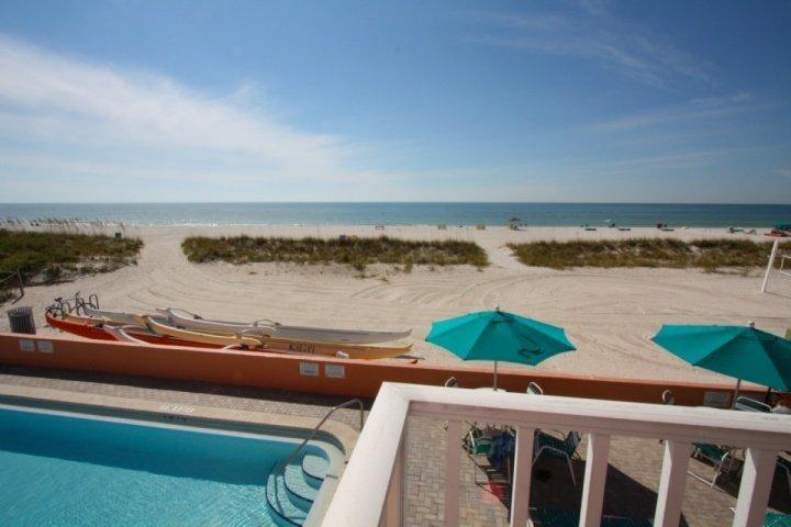 Corner beachfront balcony overlooking the pool and Gulf