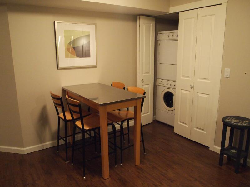 Front load laundry next to dining area