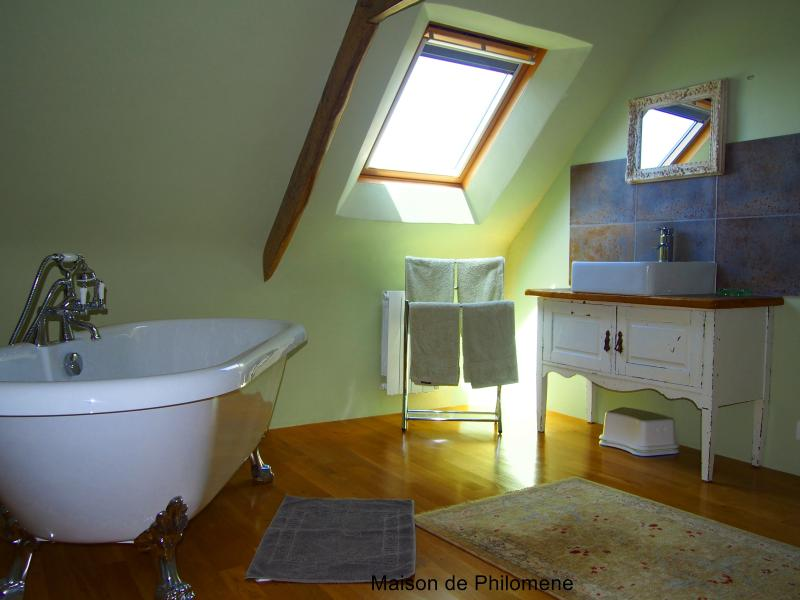 2nd floor bathroom . Adjacent to the bedroom allows this to be either an en-suite or used by all.