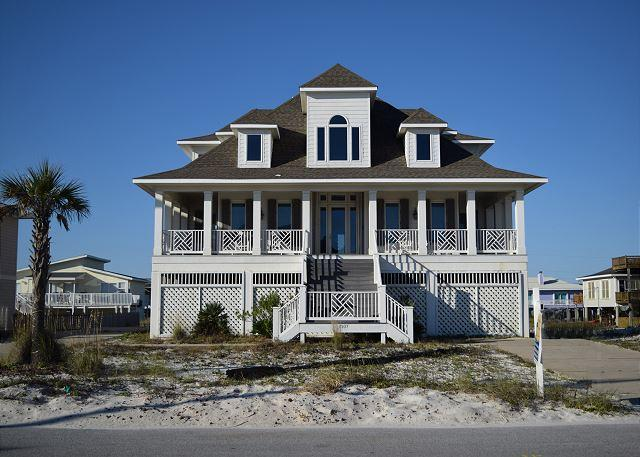 Beautiful gulf view home has great front and back porches and spacious interior.