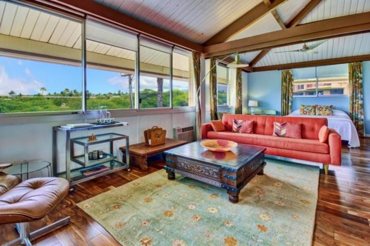 Bright and sunny open floor plan with hardwood floors.