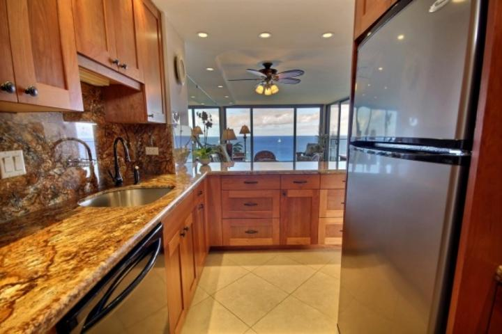 Full sized appliances, cherry wood cabinets and granite top counters