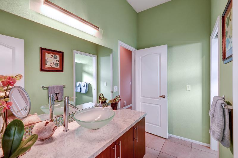 Guest bathroom with glass bowl sink, marble counters,  just beautiful.