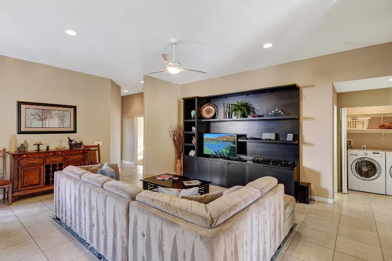 Entertainment center with large flat screen TV, surround sound and more.