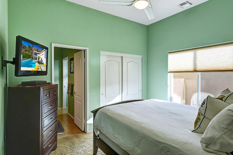 Guest bedroom with flat screen TV and cable.