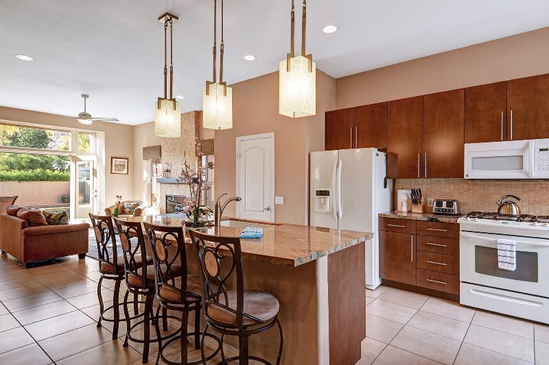Gourmet Kitchen With Granite Countertops And Designer Lighting