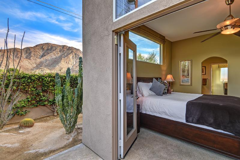 Master bedroom with french door to private patio with desert landscaping