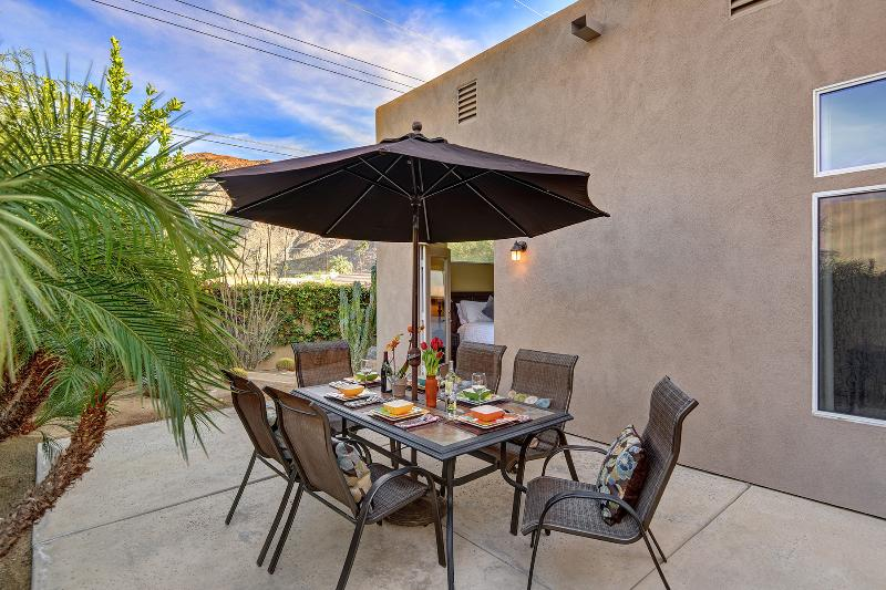 Rear Patio With Coral Ridge In Background, Table And Chairs For Six And Gas Barbecue