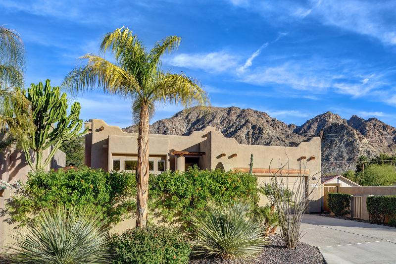 Gorgeous contemporary Santa Fe style home, 2 car garage and very private with lush desert landscape