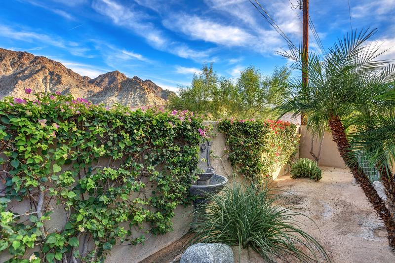 Rear yard area off of patio with desert landscape and view to Coral Ridge Mountains
