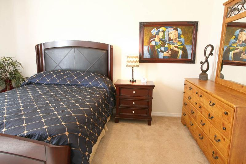 Master Bedroom has a flat screen TV.  The queen sized bed sleeps 2.